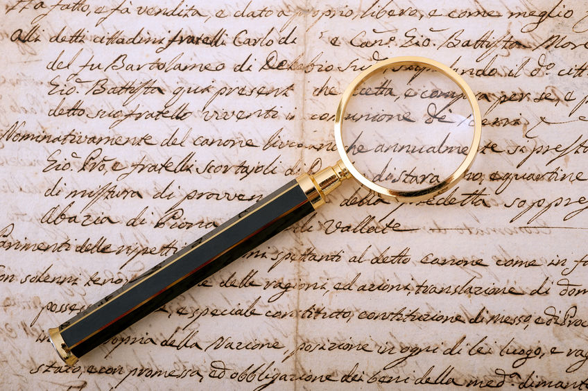 29043308 - magnifying glass on an old handwritten letter