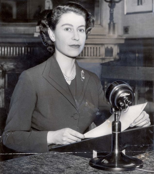 The Queen pictured at the microphone during her inaugural Christmas message in 1952; Daily Mail